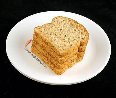این غذاها تنها 200 کالری دارند,نان (90 گرم = 200 کالری Calories)