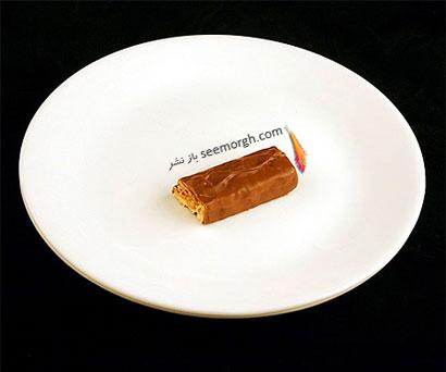 این غذاها تنها 200 کالری دارند,شکلات اسنیکر (41 گرم = 200 کالری Calories)
